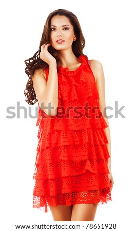 woman in red dress with curly hair on white background - stock photo