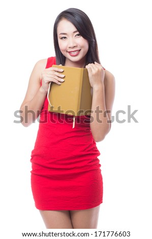 Woman in red dress with notebook - stock photo