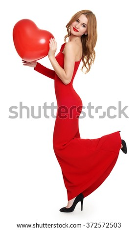 woman in red with heart shape balloon  - stock photo