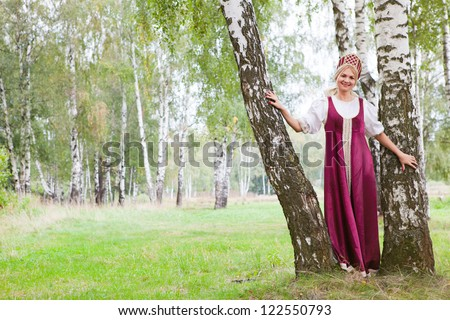 Woman in Russian traditional costume - stock photo