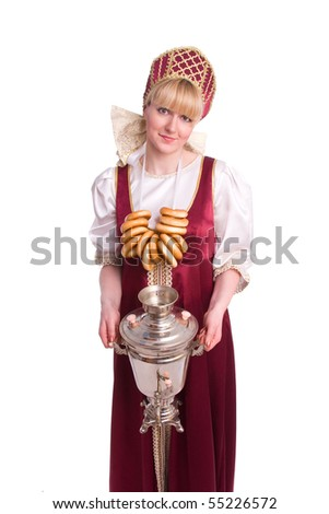 Woman in Russian traditional costume with bread-ring and samovar - stock photo