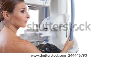 Woman in 40s ready to undergo medical scan. Isolated on white. - stock photo