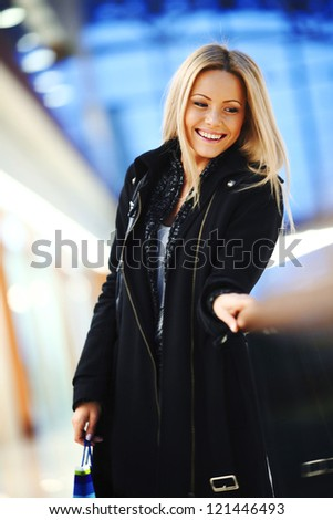 woman in shop center holds the bag in hands - stock photo