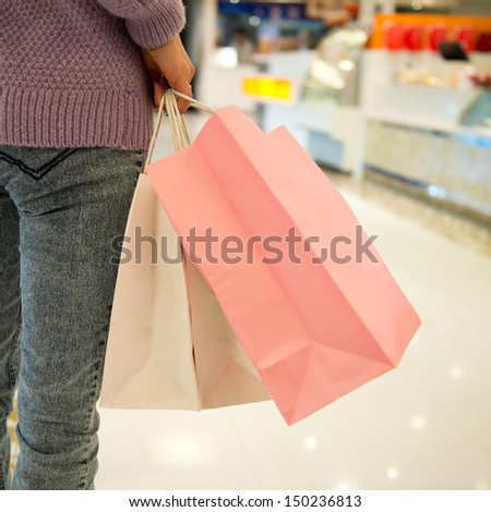 woman in shopping mall with bags.  - stock photo