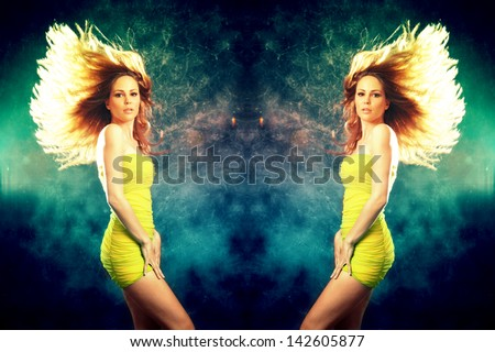 woman in short yellow dress and hair fly  dancing studio shot - stock photo