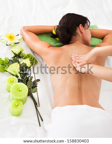 Woman In Spa Salon Lying On Towel - stock photo