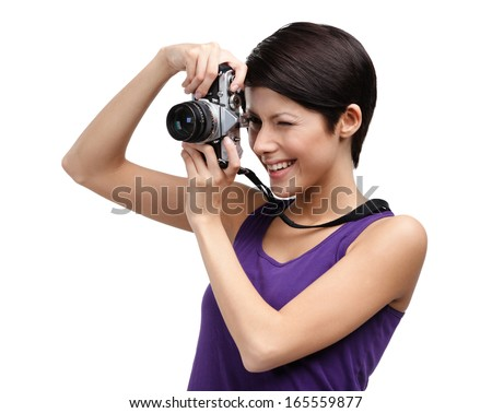 Woman in spectacles hands retro photographic camera, isolated on white - stock photo