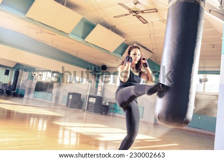 woman in sport dress at piloxing exercise - stock photo