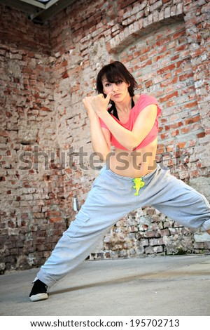 woman in sport dress dancing a fitness dance zumba or aerobics - stock photo