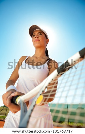 Woman in sportswear playing tennis, competition - stock photo