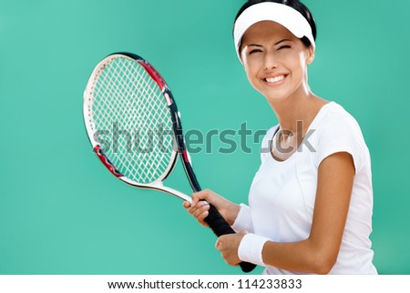 Woman in sportswear plays tennis at tournament - stock photo