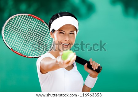Woman in sportswear serves tennis ball. Competition - stock photo