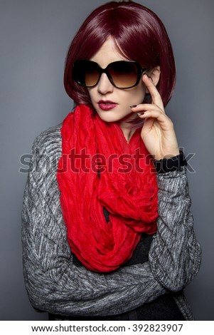 Woman in spring or fall fashion wearing retro style sun glasses - stock photo