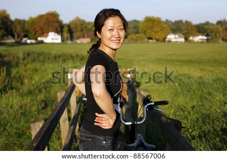 Woman in suburb cycling around Windsor - stock photo