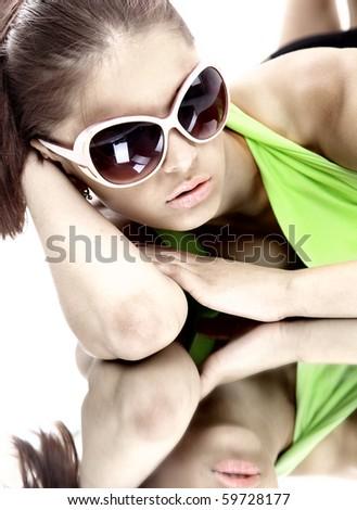 Woman in sun glasses. Fashion portrait - stock photo