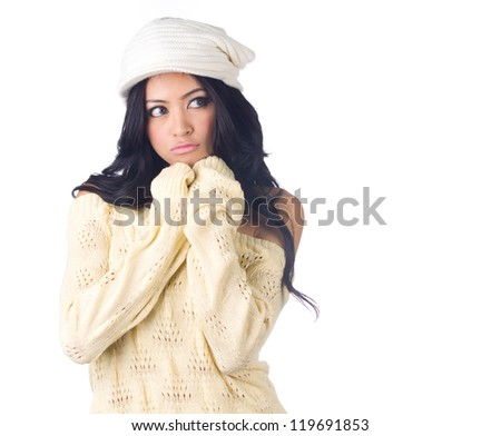 Woman in sweater with gloves  and hat looking to something on white  background - stock photo