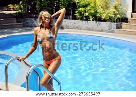 Woman in swimming pool enjoying freedom  - stock photo