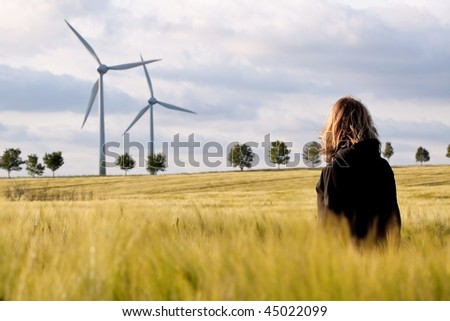 Woman in The Barley with Wind Generator - stock photo