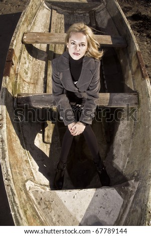 Woman in the boat - stock photo