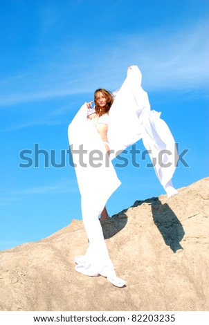 Woman in the dunes. - stock photo
