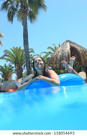 Woman in the swimming pool having fun - stock photo