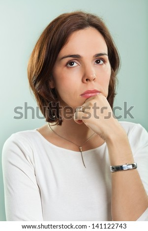 Woman in thoughts - stock photo