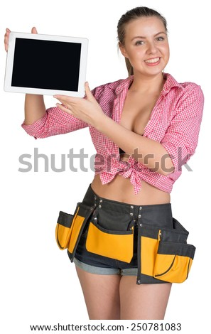 Woman in tool belt showing tablet PC with blank screen, looking at camera, smiling. Isolated on white background - stock photo