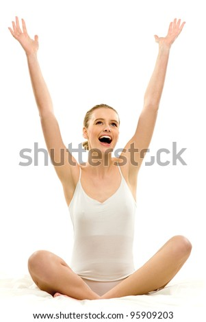 Woman in underwear with arms raised - stock photo