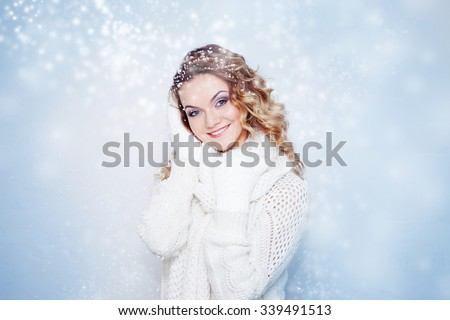 Woman  in  warm knitted scarf and gloves happy snowfall  - stock photo