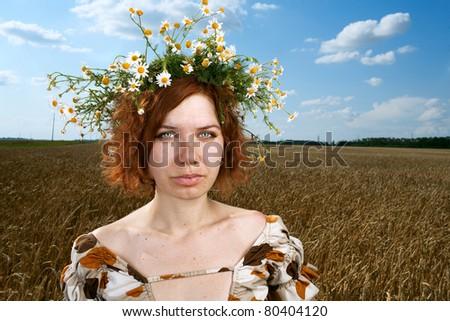 woman in wheat field under blue sky - stock photo