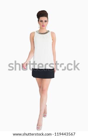 Woman in white dress walking in the mod fashion - stock photo