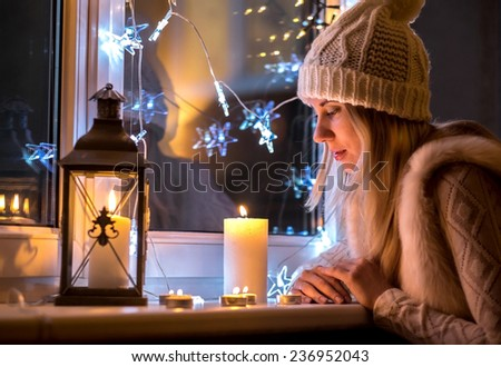 Woman in white hat in eve Christmas and New Year  - stock photo