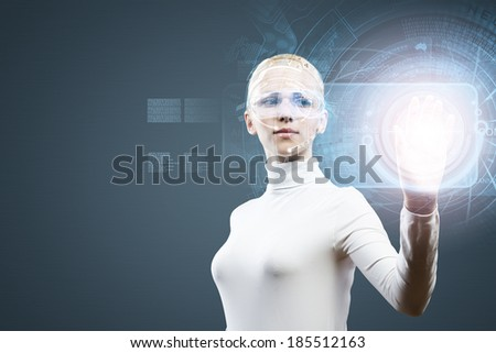 Woman in white touching icon of media screen - stock photo