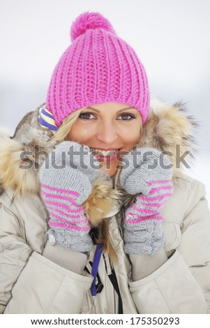 Woman in winter clothes, close-up portrait - stock photo