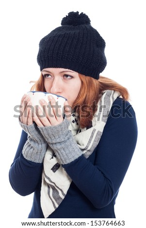 Woman in winter hat drinking hot drink, isolated on white background. - stock photo