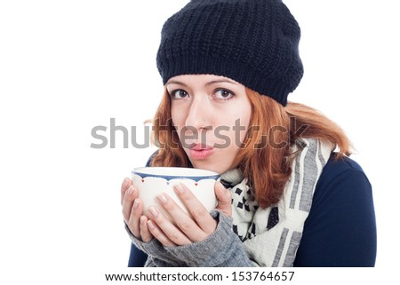 Woman in winter hat with mug of hot drink, isolated on white background. - stock photo