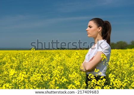 woman in yellow flower field - stock photo