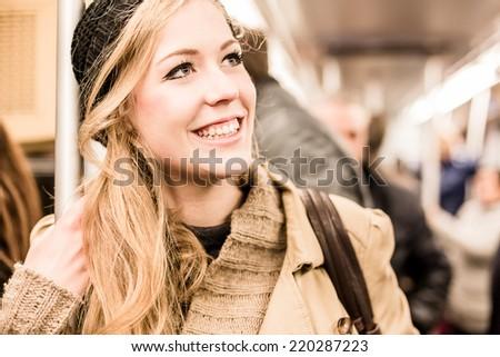 Woman inside the Metro - stock photo