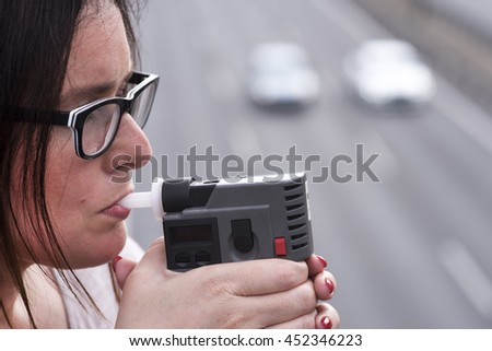 woman investigating on alkom alcohol level - stock photo