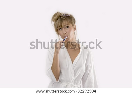 woman is cleaning her teeth - stock photo