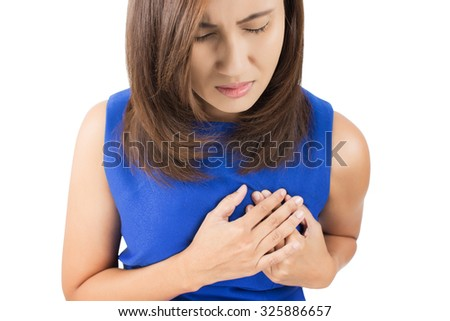 Woman is clutching her chest, acute pain possible heart attack - stock photo