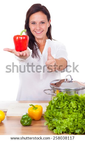 Woman is cooking healthy food - stock photo