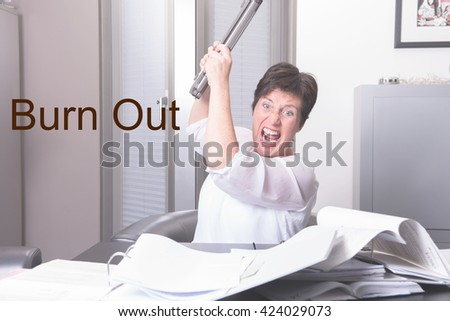 woman is destroying her PC - completely overworked - stock photo