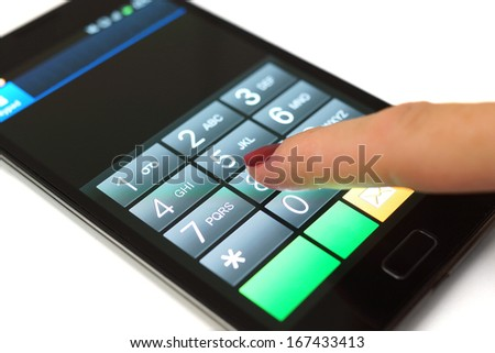 Woman is dialing on mobile touchscreen phone - stock photo