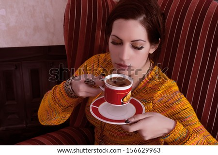 woman is drinking coffee - stock photo