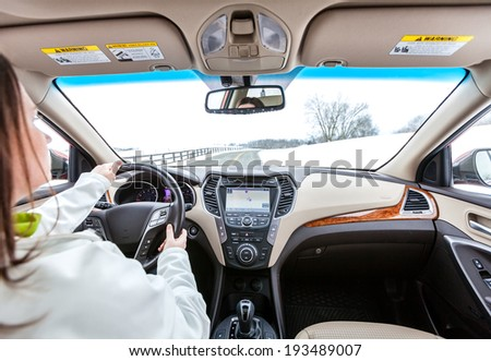 Woman is driving a car - stock photo