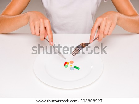 Woman is eating a pills and drugs. Concept of healthy food, diet. - stock photo