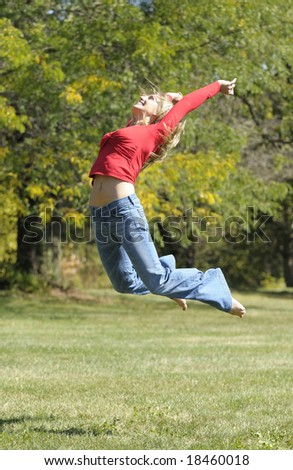 woman is jumping in the park - stock photo