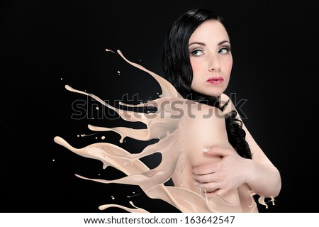 Woman is melting into a liquid  - stock photo