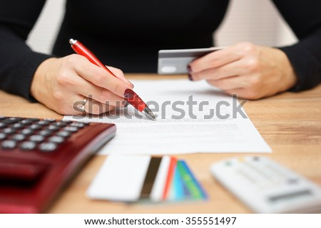 woman is opening bank account and checking  credit card information - stock photo